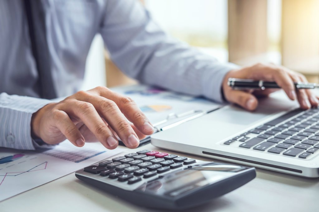 Accountant working on financial calculations.