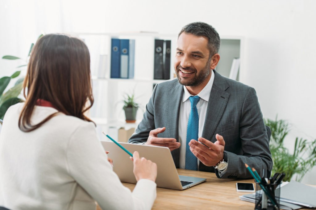 Advisor discussing with a woman inside the office.