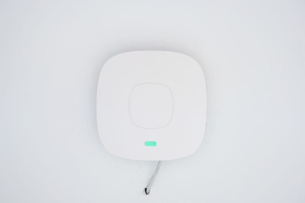 White ceiling access point wifi.