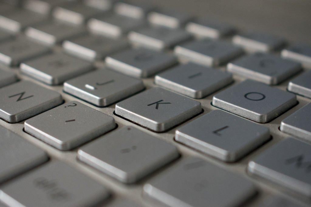 Close-up of computer keyboard with focus on the letter K.