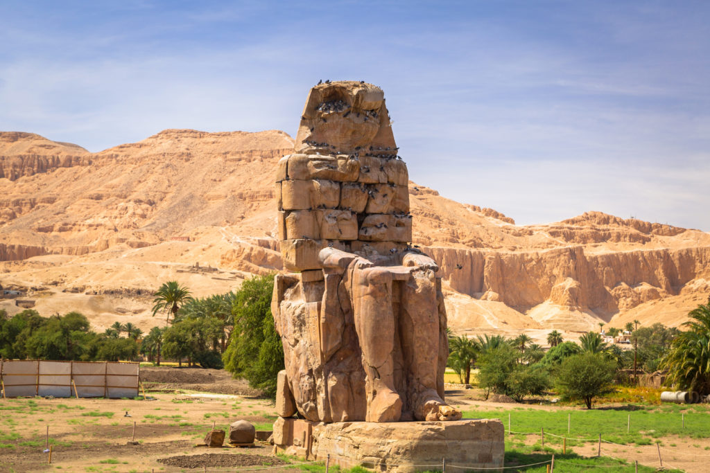 The Colossi of Memnon, two massive stone statues of Pharaoh Amenhotep III in Egypt.
