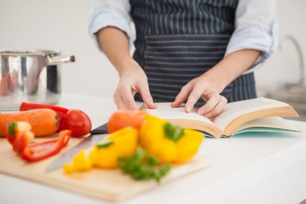 Cook following a recipe book.