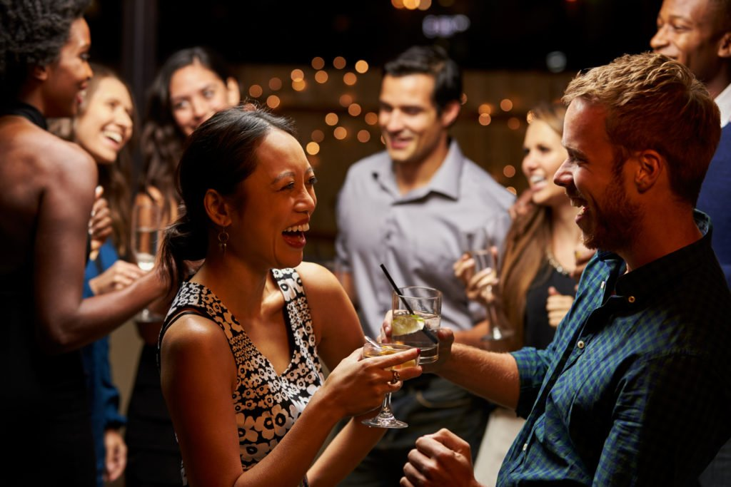 Couple dancing and enjoying at an evening party.