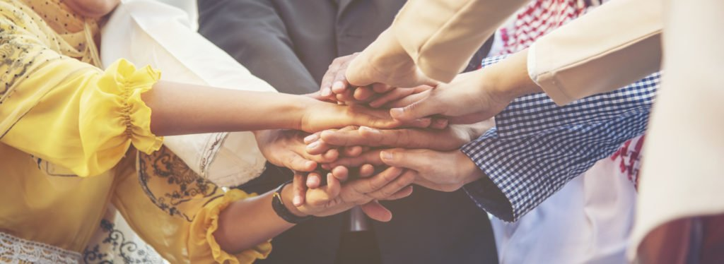 Group of people diversity multiethnic teamwork collaboration team meeting communication  Unified team concept. Business people hands together diversity multiethnic diverse culture partner team meeting.