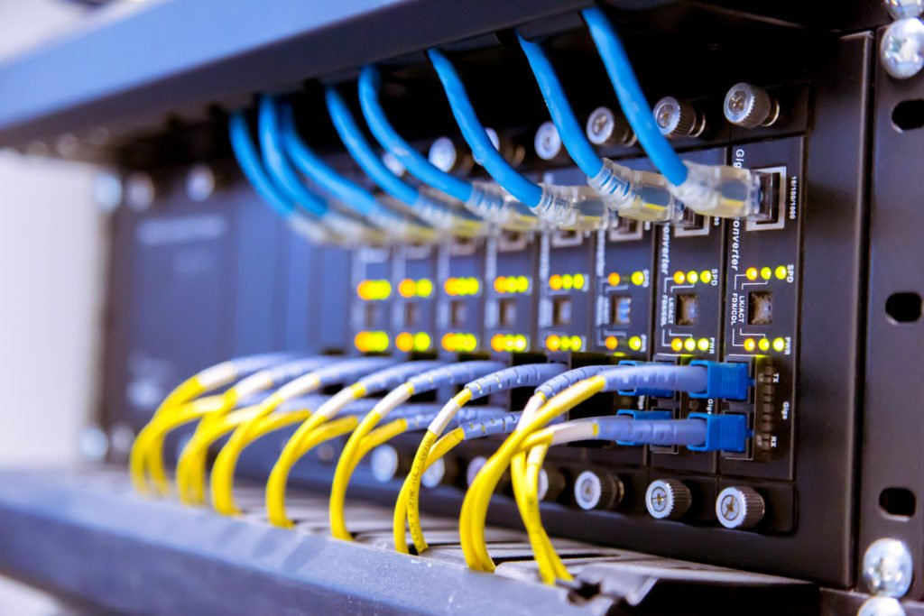 Network switch and ethernet cables in a data center.