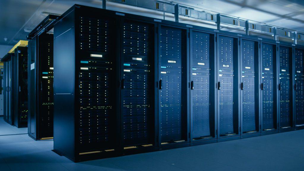 Data center with multiple rows of server racks.