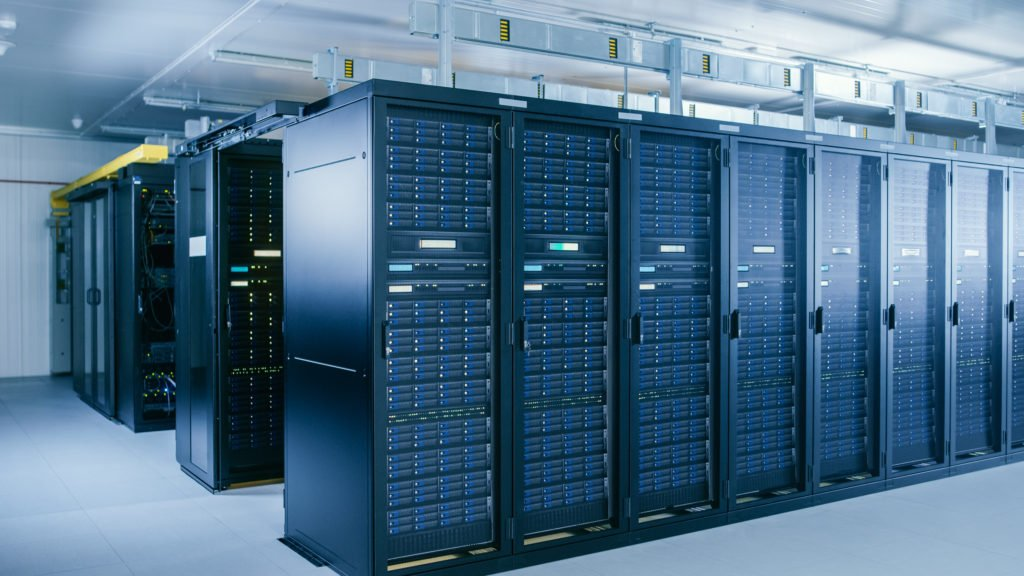 Shot of data center with multiple rows of server racks.