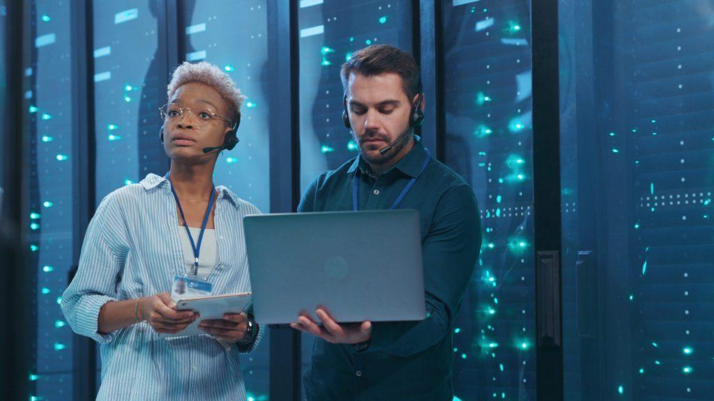 Data center specialists inside a server room.
