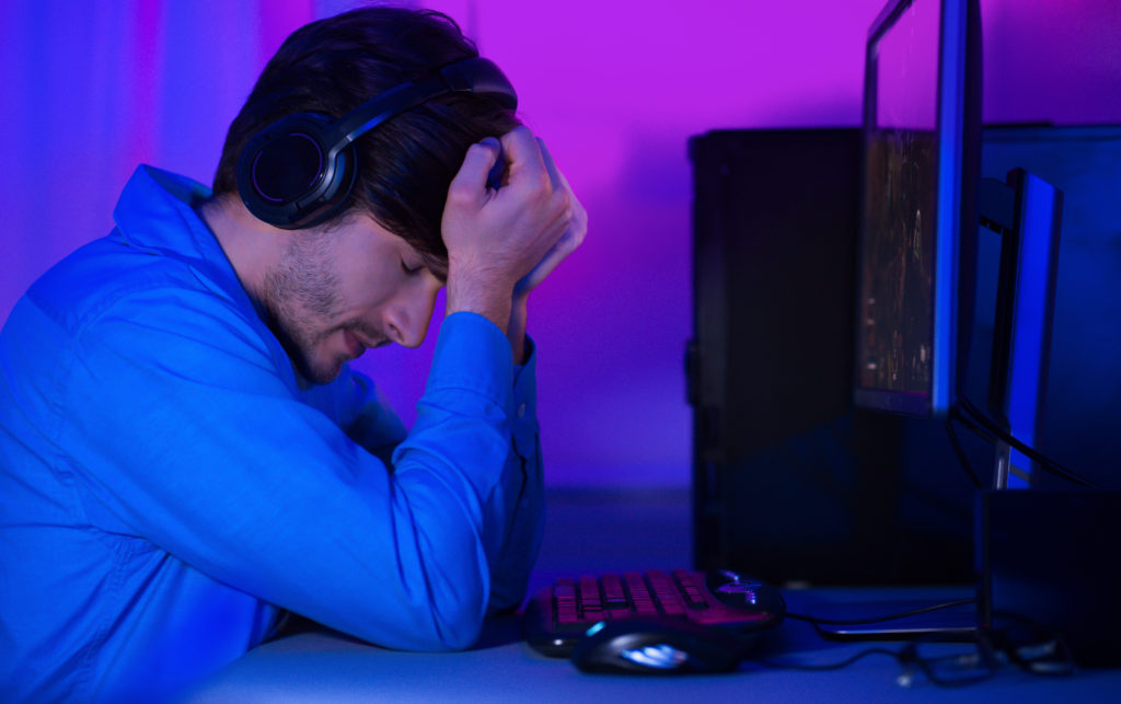 Disappointed and upset gamer after he lost a game.