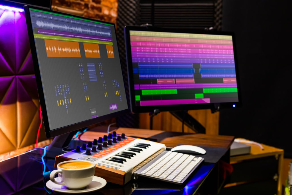 Dual display monitor and midi keyboard for music production.