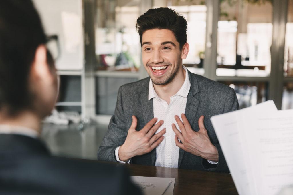 Enthusiastic man having a job interview.