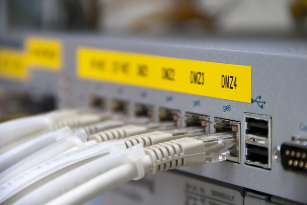 Ethernet cables connected to a firewall.