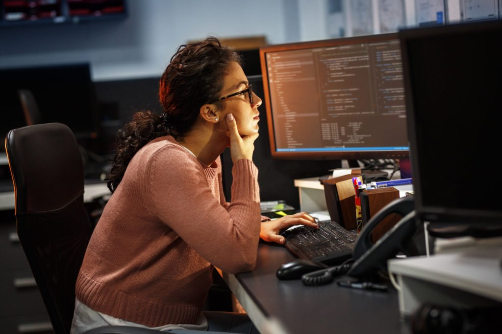 Female programmer working late on a project.