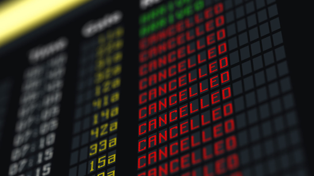 Flights cancelled displayed on an information board.