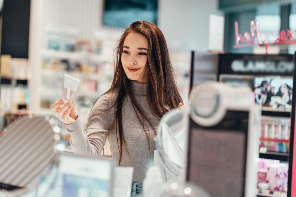 Girl buying products in the cosmetics store.