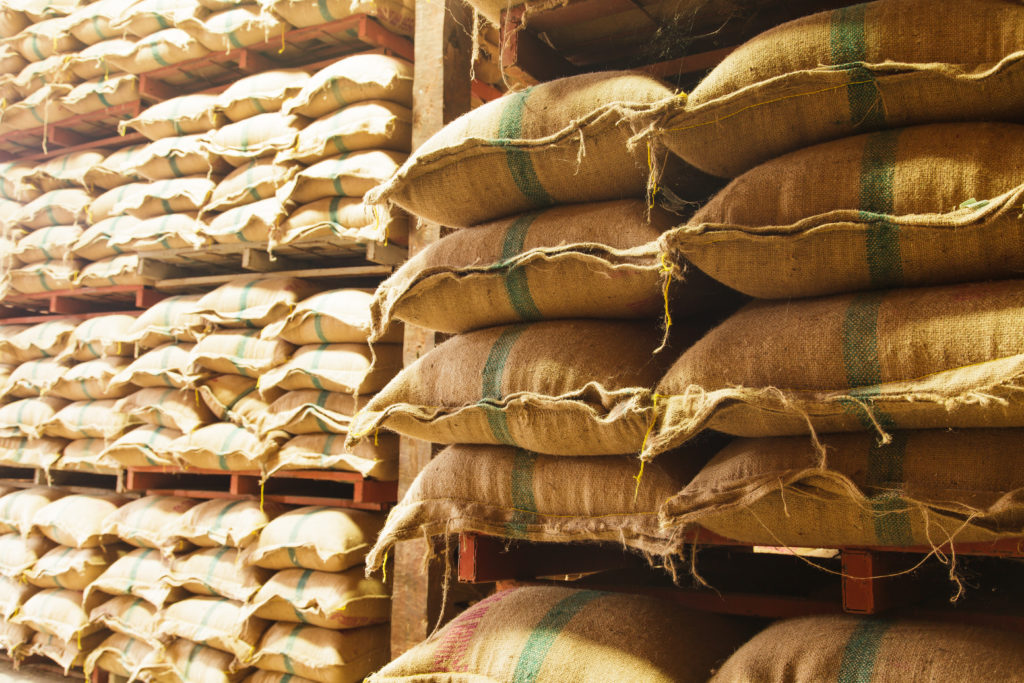 Stack hemp sacks of rice in the warehouse.