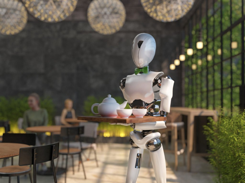 A humanoid robot waiter carries a tray of drinks in a restaurant.