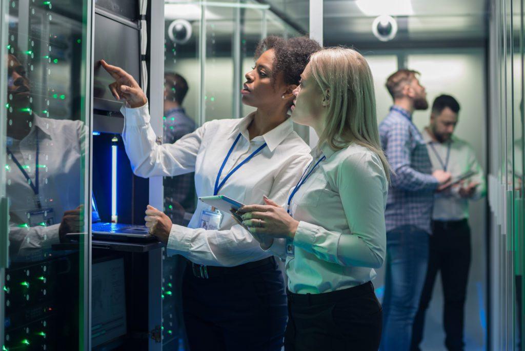 IT engineers working inside a server room.
