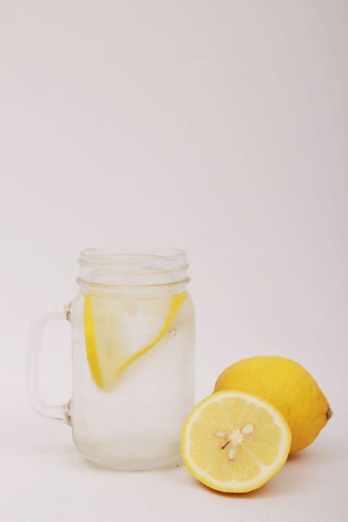 Lemonade jar and lemons.