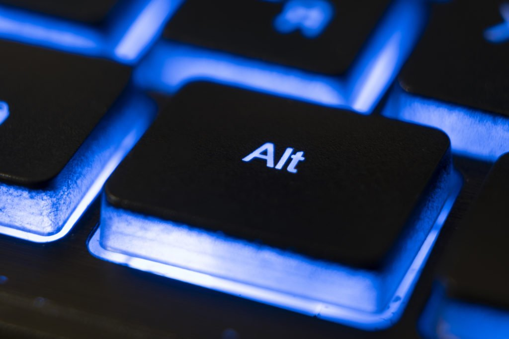 Macro shot of ALT button of a blue keyboard.