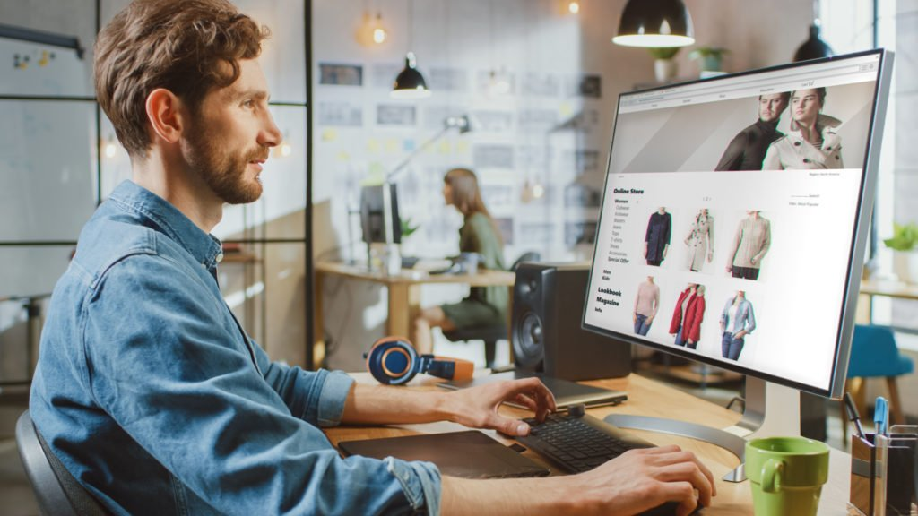 Man scrolling through an online fashion store website.
