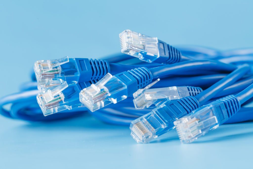 Blue computer ethernet cables with blue background.