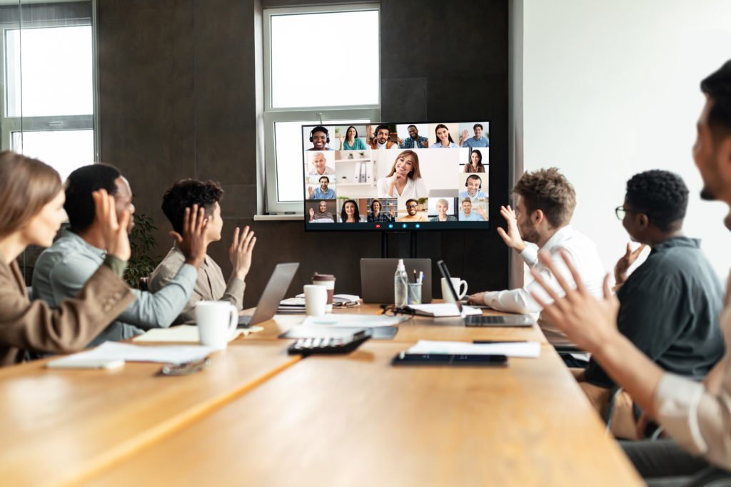 Online video call with employees inside the office.