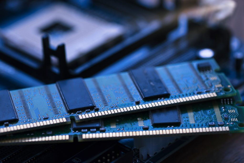Pair of RAM placed on top of motherboard.