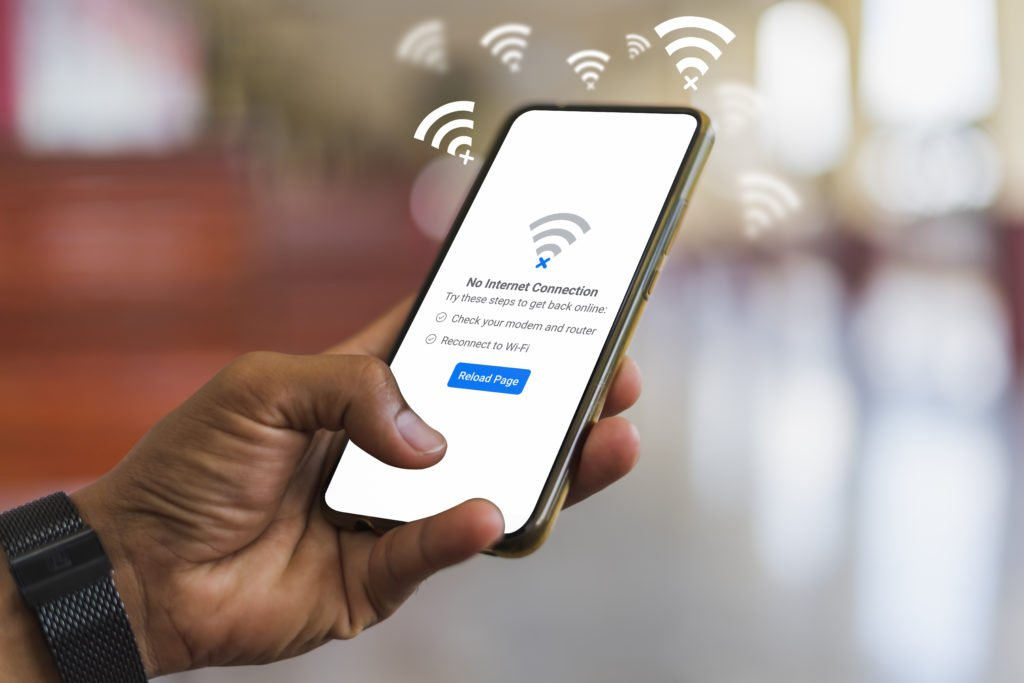 Man holding smartphone but can't connect to wifi.