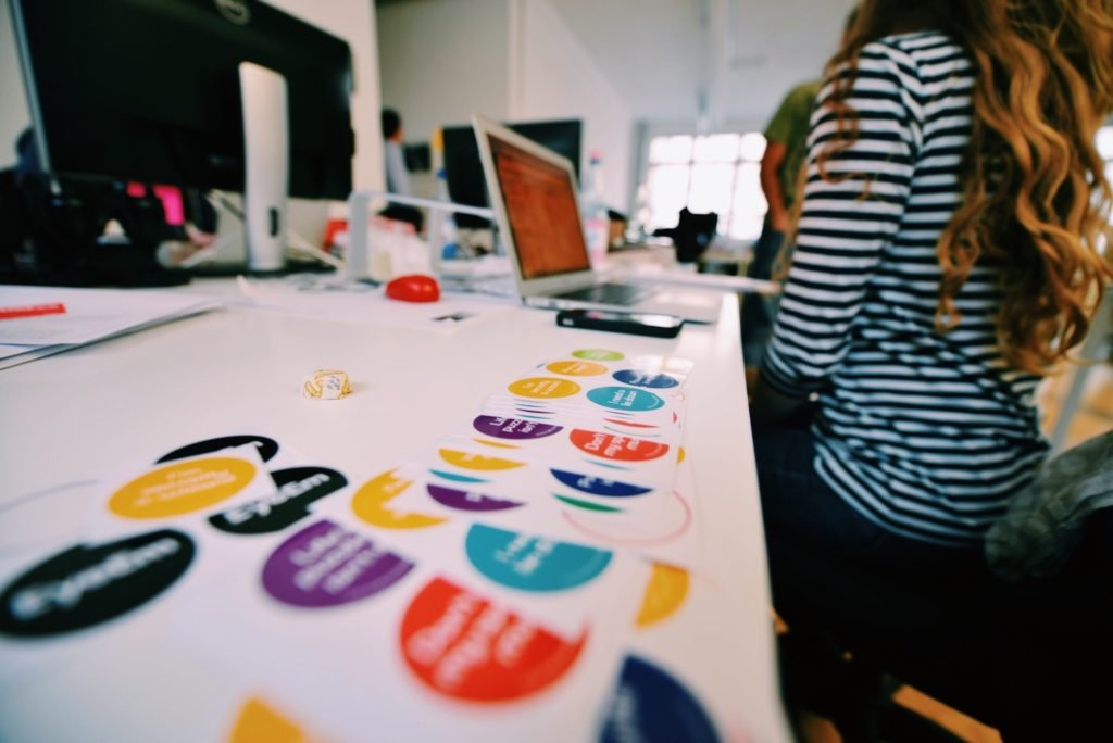 Close-up of printed stickers on an office desk.