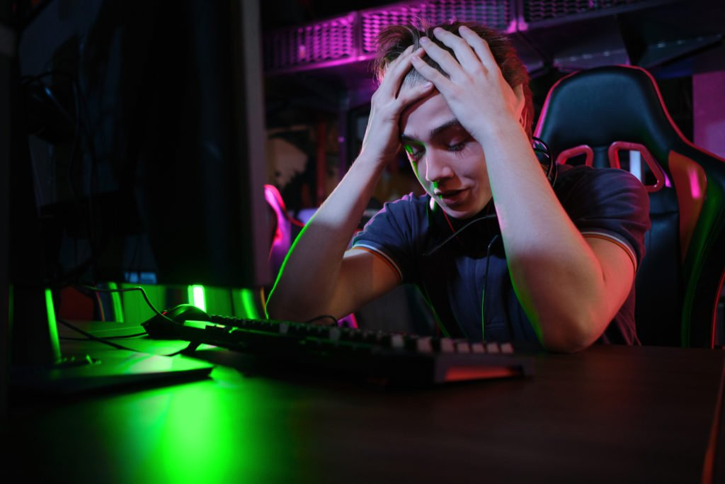 Professional gamer feeling upset with the game.