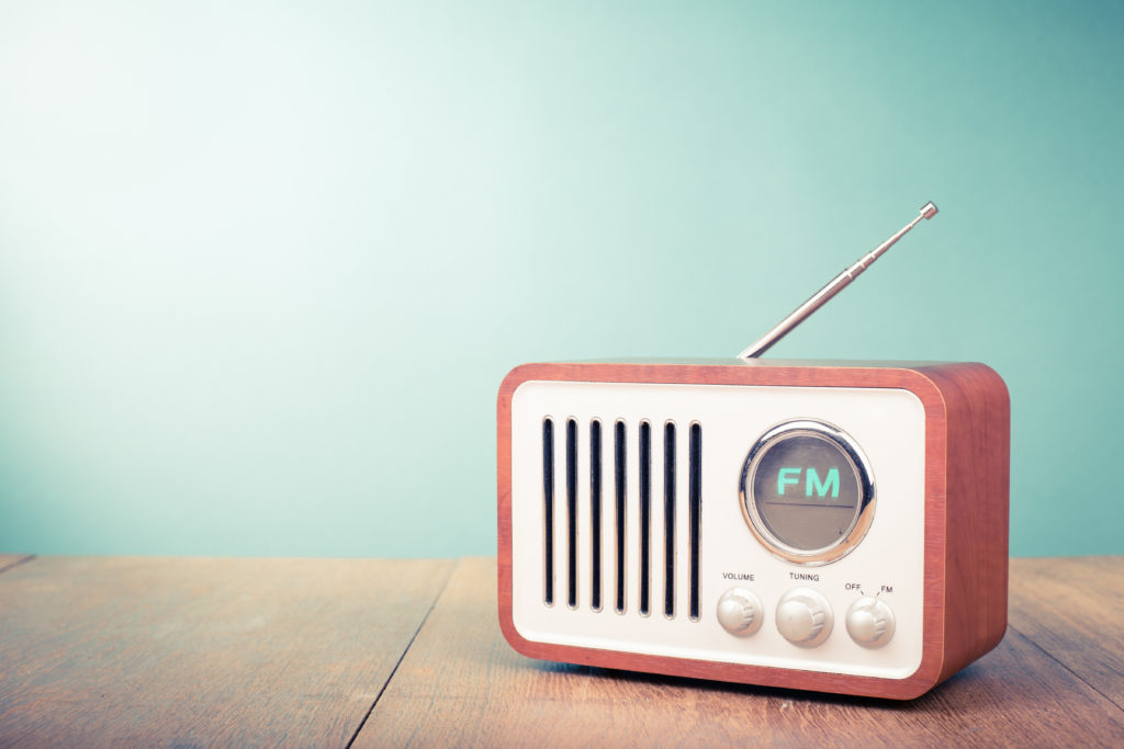 Retro old radio front mint green background. Vintage style filtered photo.