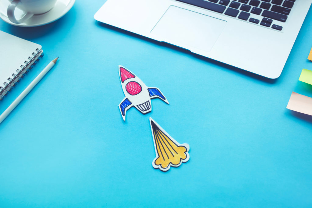 Business start up concept with rocket on desk table color.Creativity innovation ideas.