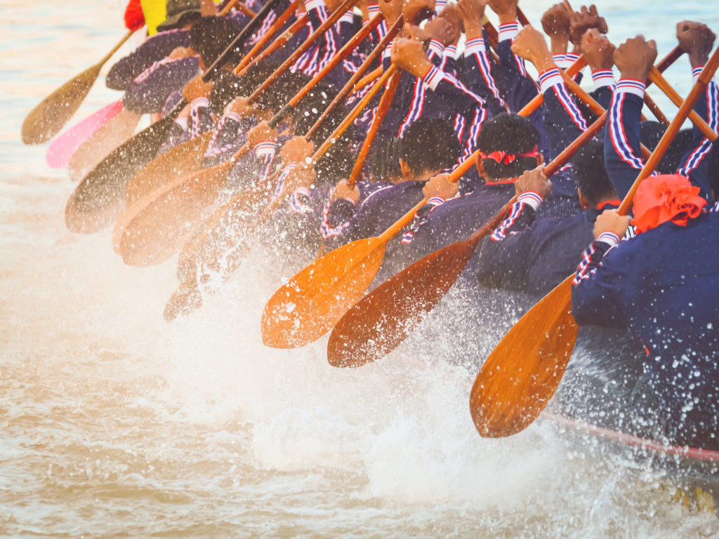 Close up of rowing team race.