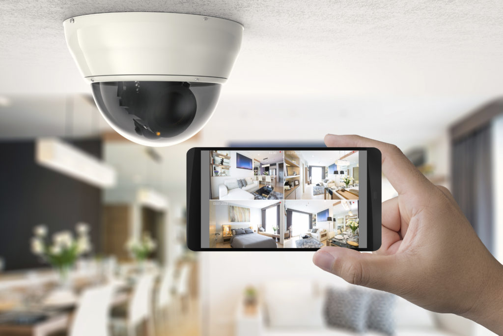 Hand holding 3d rendering mobile connect with security camera.