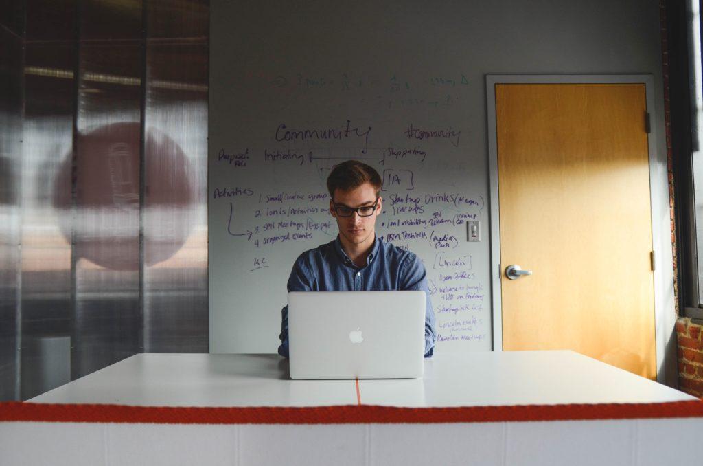 Single working man behind a laptop.