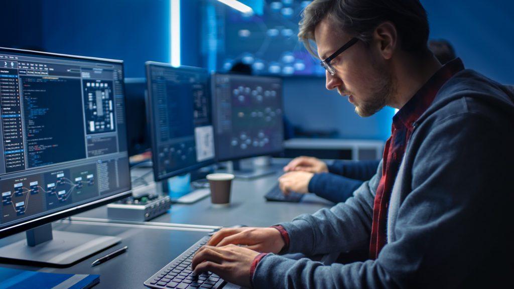 Software developer working inside the control room.