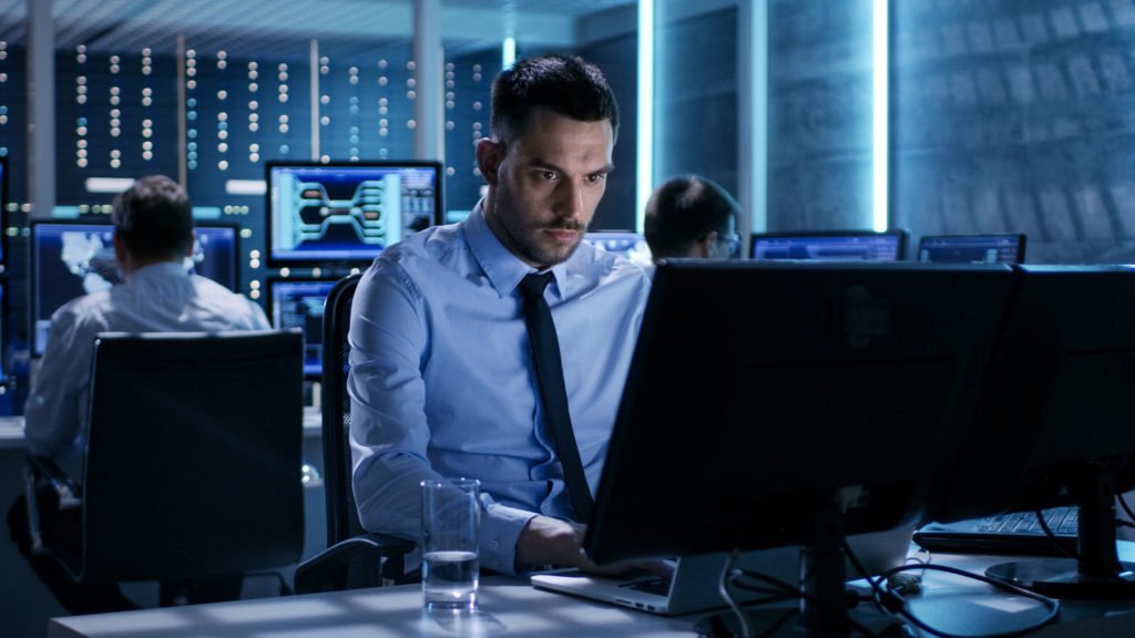 Technical engineer working in a monitoring room.
