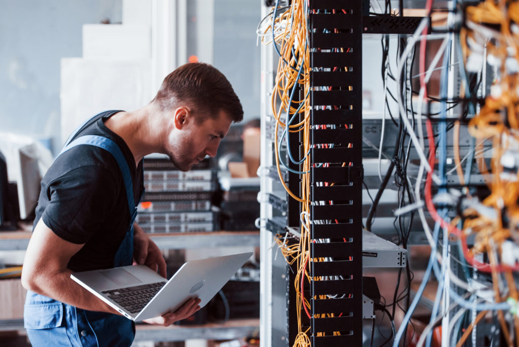 Technician fixing server equipment.
