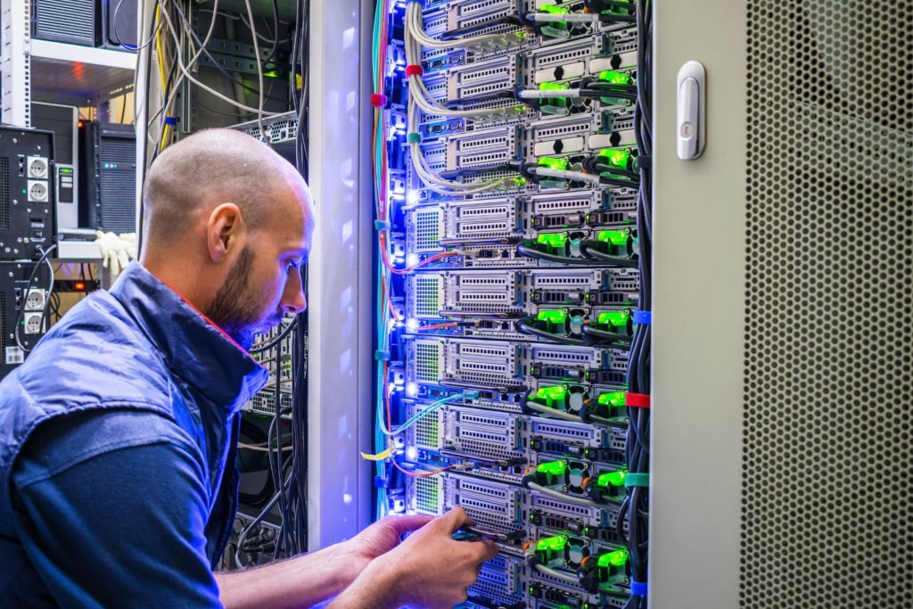 Technician fixing the internet server cables.