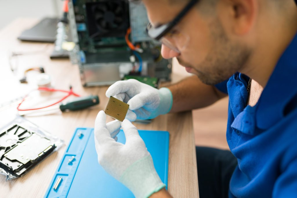Technician looking at a microchip.