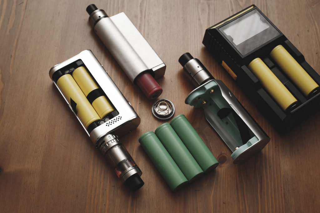 Vape devices with charger and batteries.