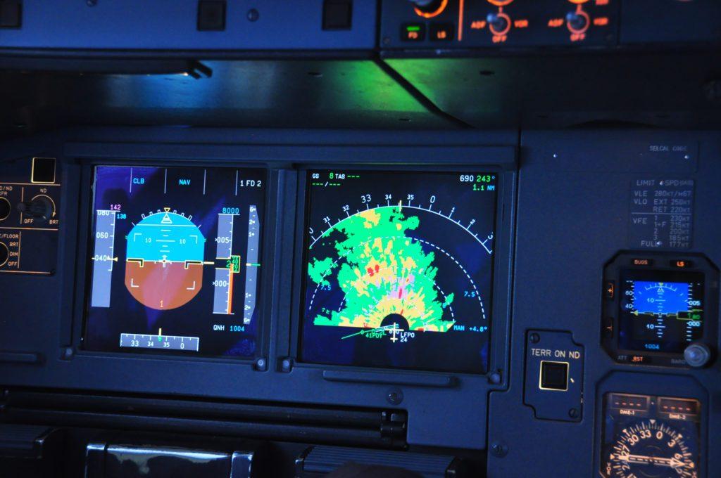 Close-up shot of weather radar on the navigation display screen.