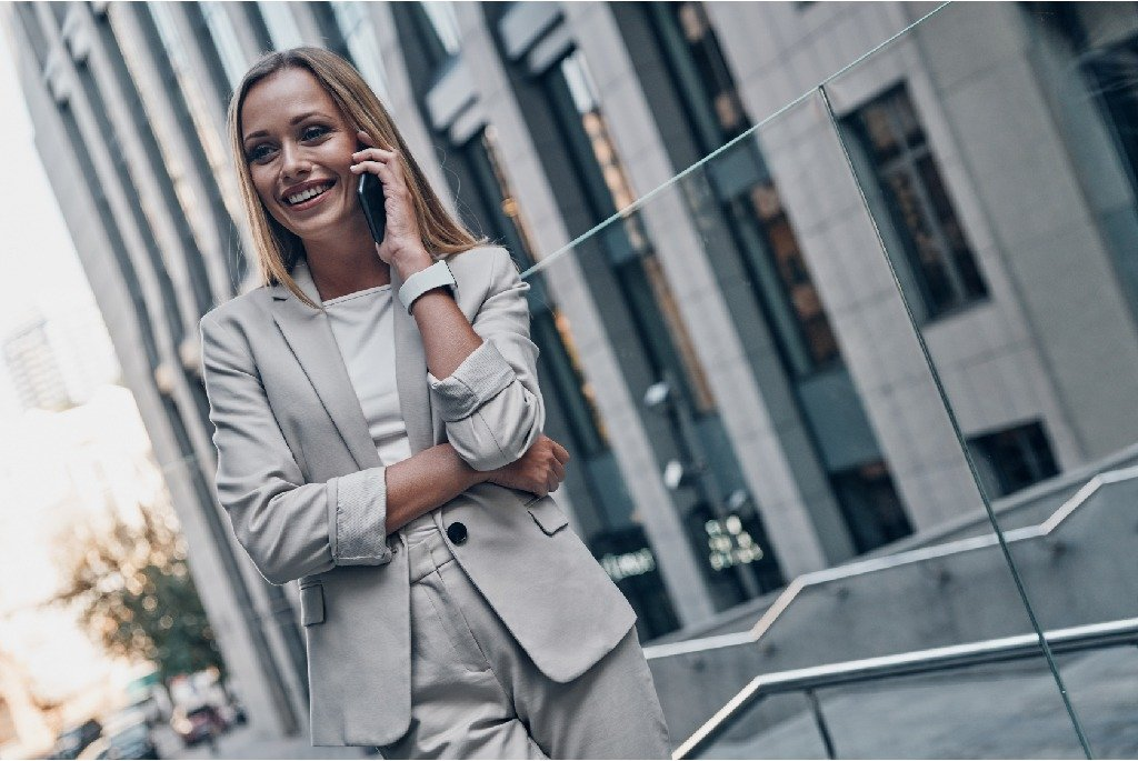 Woman talking on a business smartphone.