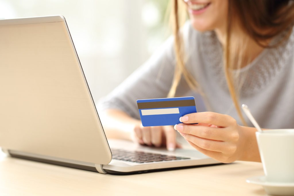 Woman buying online with her credit card.