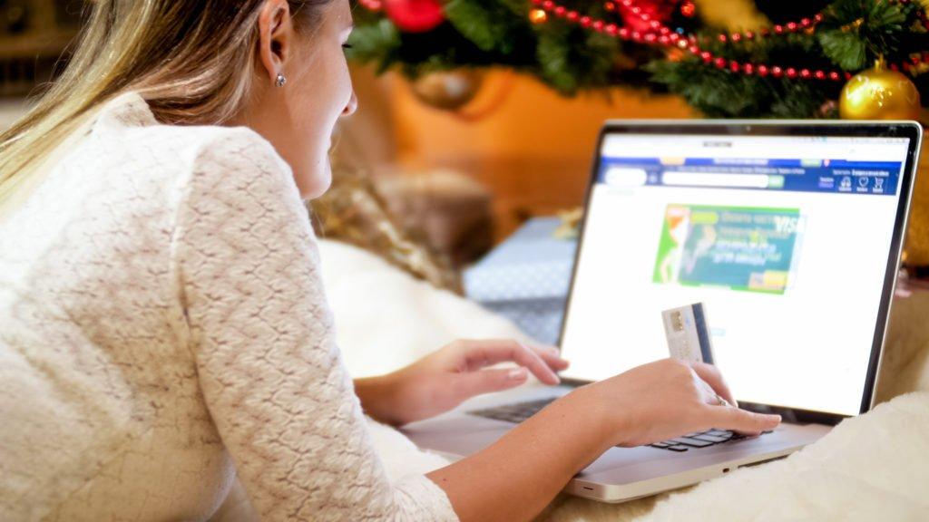 Woman ordering Christmas gifts online.