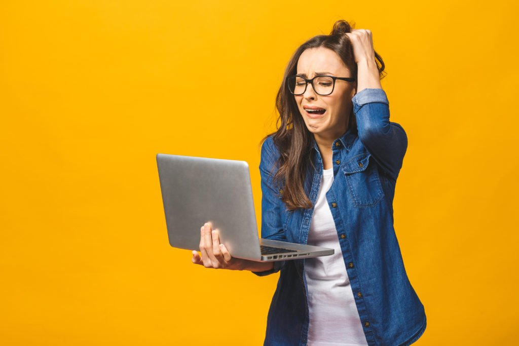 Woman having a work overload, yellow background.