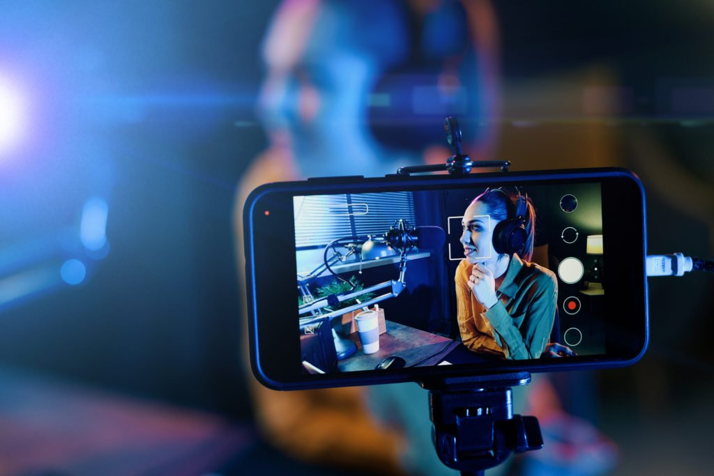 Woman hosting and livestreaming video on her phone.
