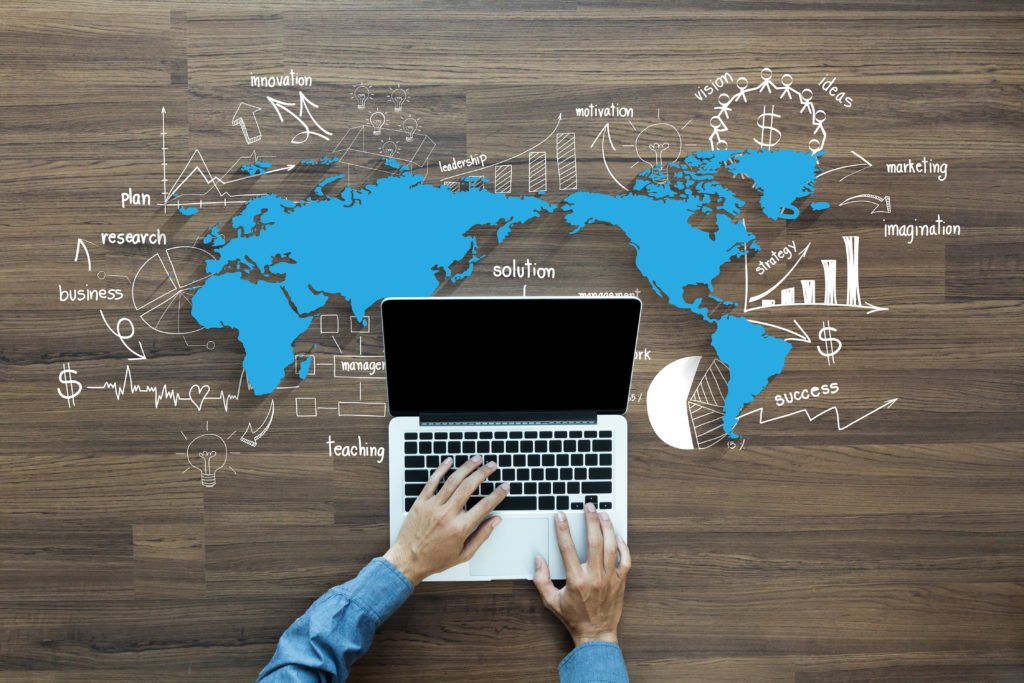 World map with creative drawing charts and graphs business success strategy plan ideas, With Man hand working on laptop computer keyboard with blank screen monitor.